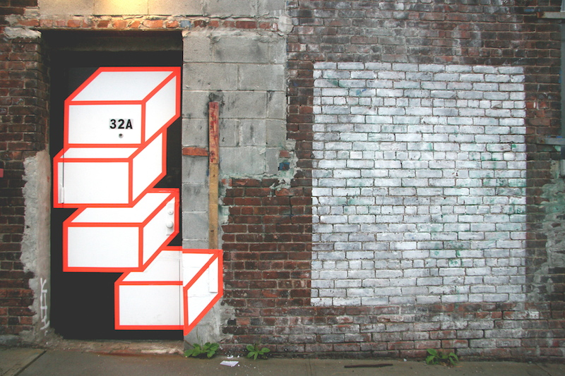 Relatively fresh street art made of tape by Aakash Nihalani. Photo by carnagenyc.