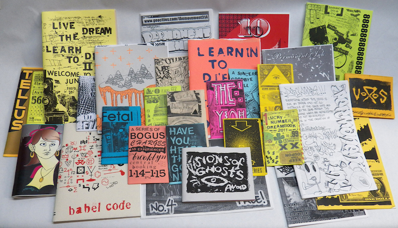 Various AVOID pi zines. Photo by Adam Void.