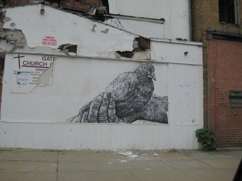 A wheatpaste by Gaia in Baltimore. Photo by Hank Mitchell.