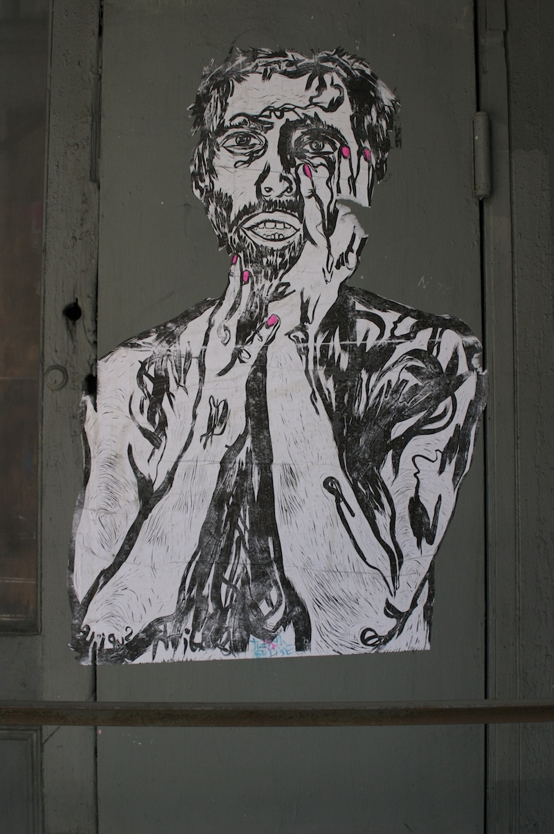 A wheatpaste of a block print by Judith Supine. Photo by Garrison Gunter.
