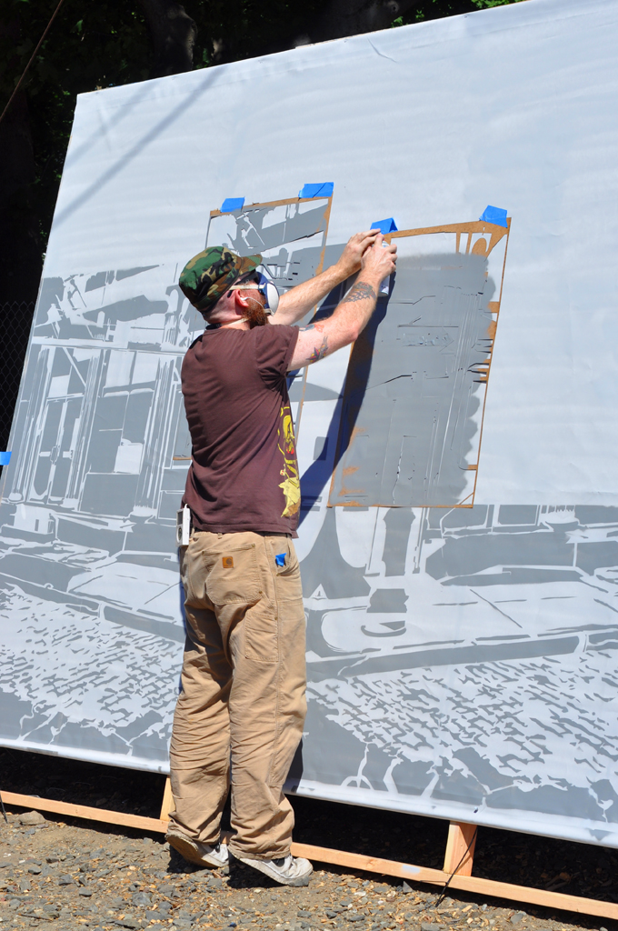 Logan Hicks at work on the mural he painted for the Electric Windows project in Beacon, New York in 2010. Photo by Jason Persse.