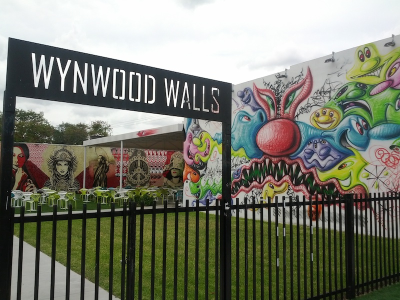The entrance to Wynwood Walls in Wynwood, Miami with work by Kenny Scharf inside. Photo by Joe Anzalone.